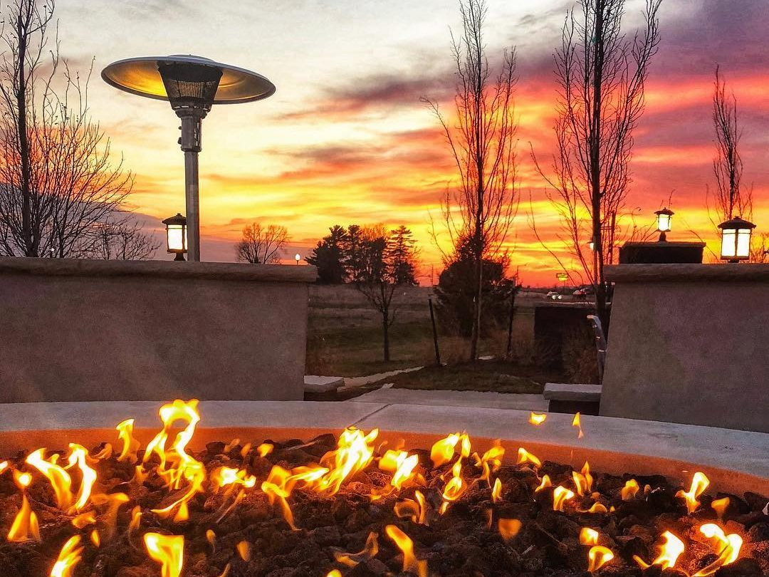 Firepit at sunset on Tin Roost patio
